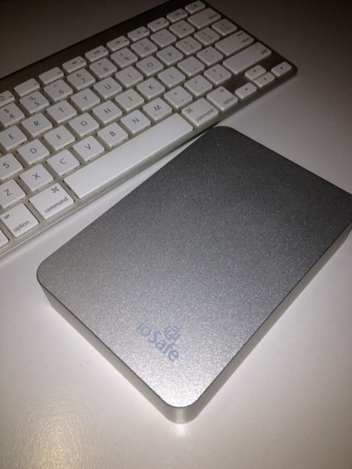 ioSafe Rugged Portable SSD beside my Apple Wireless Keyboard. The anodized aluminium of the ioSafe looks really good